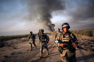 an iraqi army soldier conducts a foot patrol together with u.s. army soldiers from fox troop, sabre squadron, 3rd armored cavalry regiment, after they set a deserted village on fire, balad ruz, diyala province, iraq, 2008. 20 kms south of  balad ruz, fox troop, sabre squadron, 3acr, burning everything(AP Photo/Marko Drobnjakovic)
